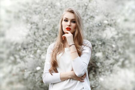 goodly: Spring portrait of a beautiful girl with red lips in the spring time.