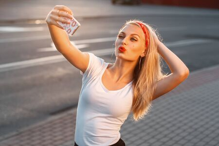 lips smile: Pretty hipster girl taking selfie and making duck face.
