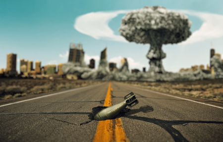 nuclear explosion: Bomb on the road. Background a nuclear explosion. Stock Photo