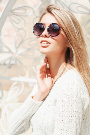 sexy sweater: Beautiful young fashionable girl in round sunglasses