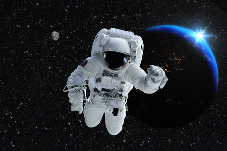 spaceship: Astronaut spaceman outer space people planet earth moon. Beautiful blue sunrise.