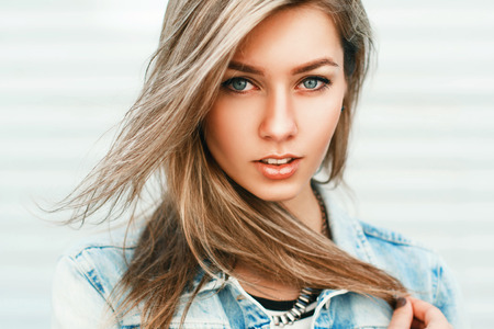 denim jacket: Close up portrait of a pretty woman from Europe in a denim jacket. Stock Photo