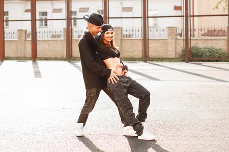 Beautiful couple dancing hip-hop.