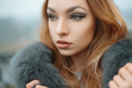 blonde teenager: Beautiful girl in a fur jacket