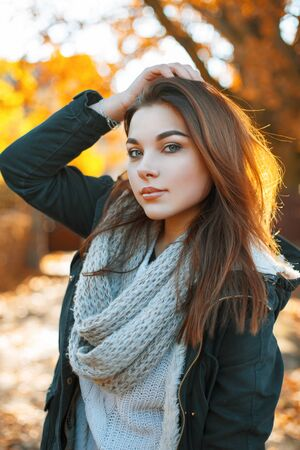 happy face: Beautiful girl in a knitted sweater and jacket in the autumn park Stock Photo