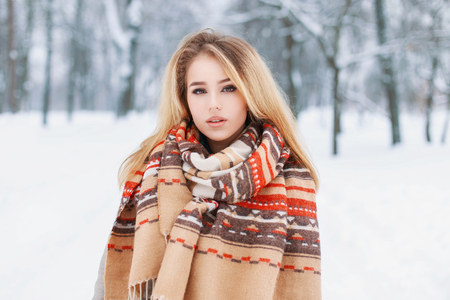 fabric patterns: Portrait of a beautiful woman with a warm vintage scarf on a winter day