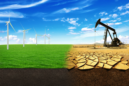 crack pipe: The concept of green energy windmills in a beautiful field. Oil pump in sandy field with cracks. Energy Production leads to the destruction of the world Stock Photo
