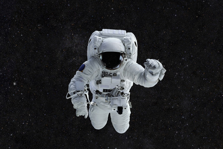weightlessness: Spaceman travels on a background of stars. Astronaut outer space Stock Photo