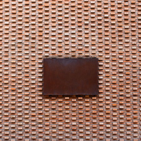 metal pattern: Beautiful vintage brick wall with rusty metal sign Stock Photo