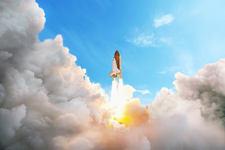 Space shuttle taking off on a mission. Spaceship flying in the sky