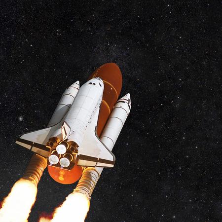spacecraft: Spacecraft shuttle on the background star field