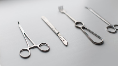 clamps: Metal set of medical instruments (scalpel blade, scissors, forceps, clamps, forceps) on a white background Stock Photo