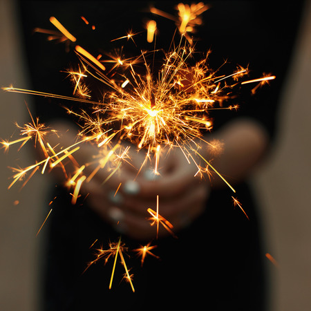 Amazing sparklers in female hands.