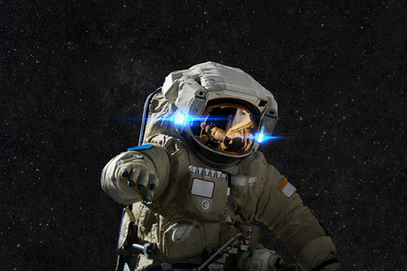 Spaceman in space on the background of stars. Reklamní fotografie