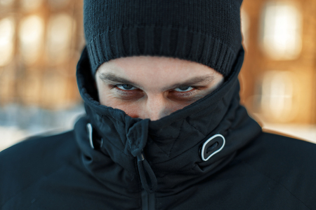 Mans face is hidden in the jacket. Male eyes