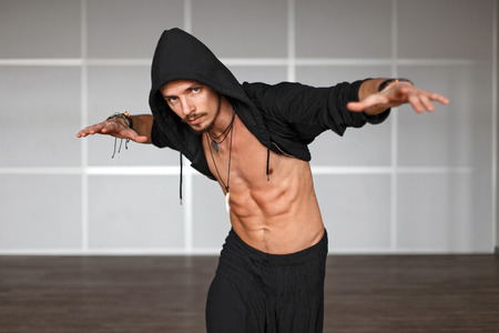 Fashionable handsome male dancer dancing on the dance floor Stock Photo