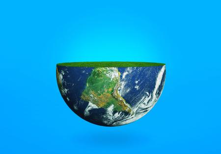 青色の背景に草と地球の半分。惑星の生態学の概念 写真素材