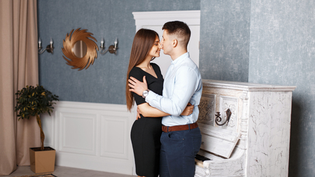 Handsome young man kisses his girl in the nose Stock Photo