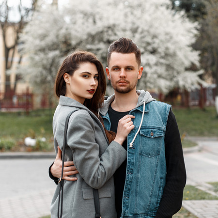 Beautiful stylish young couple hugging on the street Stock Photo