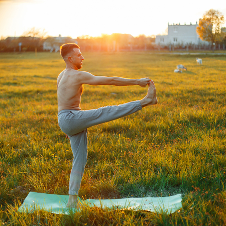 Man doing yoga at sunset. Healthy lifestyle
