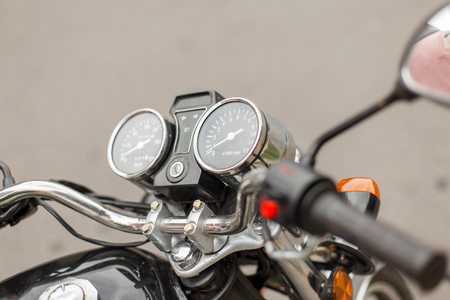 Speedometer and tachometer of a vintage motorcycle close-up