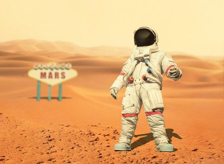 Spaceman walks on the red planet Mars. Space Mission. Welcome to Mars sign. Astronaut travel in space