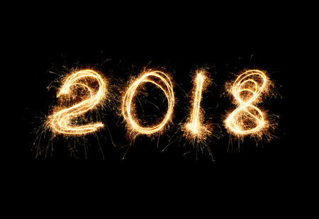 New year 2018 light. Sparklers draw figures 2018. Bengal lights and letter