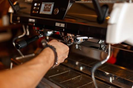 Barista preparing espresso, coffee making process