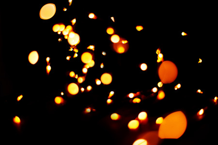 Festive Christmas and New Year lights. glitter vintage lights background. dark gold and black. defocused