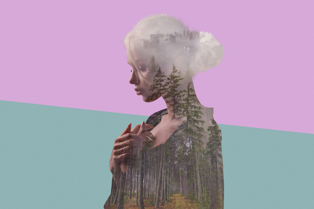 Creative double exposure. Young girl with nature. forest, trees, fog and city inside the body