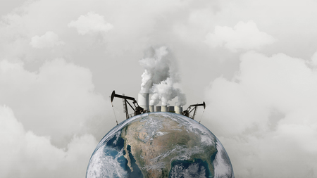 Concept pollution of the environment. Oil rigs and an atomic plant on the planet earth Stok Fotoğraf