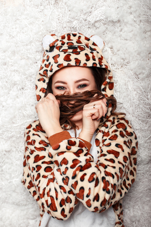 happy young woman in funny pajamas covers face with her hair Reklamní fotografie
