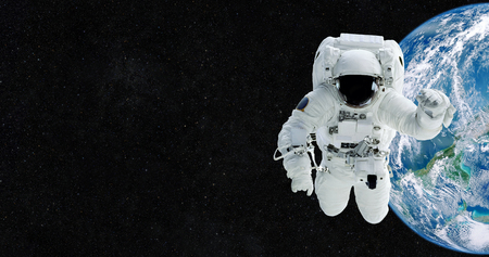 Astronaut in an outer space against the backdrop of the planet earth.
