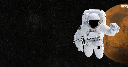 Astronaut in space against the background of the planet Mars
