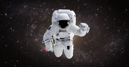 Astronaut in the open space against the background of the galaxy
