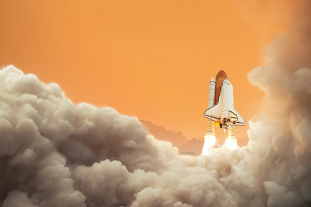 Spaceship on the planet Mars. Rocket takes off on Mars. Space shuttle taking off on a mission.