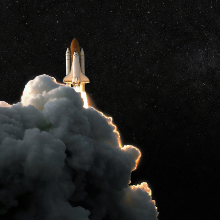 Spaceship rocket and starry sky. spacecraft flies into space with clouds of smoke 写真素材