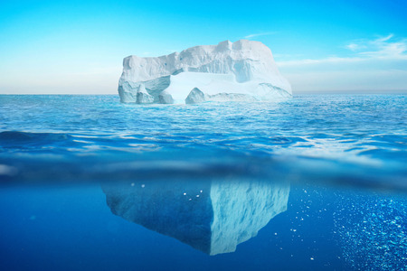Underwater view of iceberg with beautiful transparent sea. Hidden Danger And Global Warming Concept Фото со стока