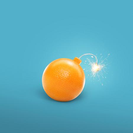 Concept of an orange bomb. Creative bomb with sparks. Juicy Orange Stock Photo