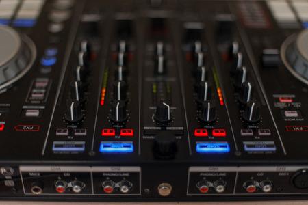 Audio controller. Mixer for DJ