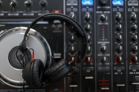 Stylish DJ headphones and mixing console top view