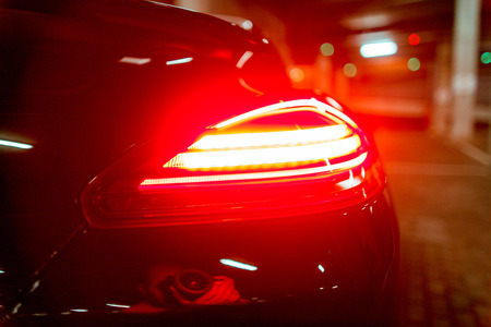 Modern luxury black car with stop lamp at night Stock Photo