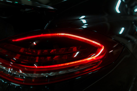 modern stop lamp of a luxury car lights red. Led