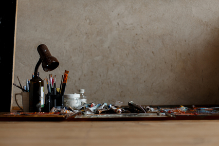 Old place for the artists work with vintage brushes and tools. Art