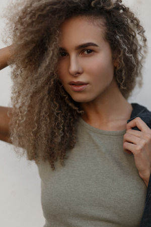 Stylish beautiful curly girl in a fashion T-shirt. Natural beauty Stock fotó