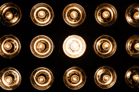Beautiful bright electric vintage glass spotlights on a black background. Bright light. Close-up