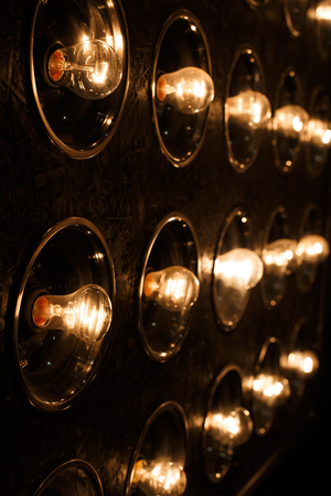 Electric bright gold vintage incandescent bulbs. Close-up
