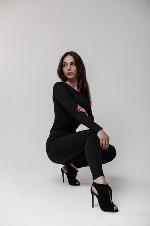 02760bf19d790 Young beautiful woman in a stylish T-shirt in stylish black leggings and  leather stylish