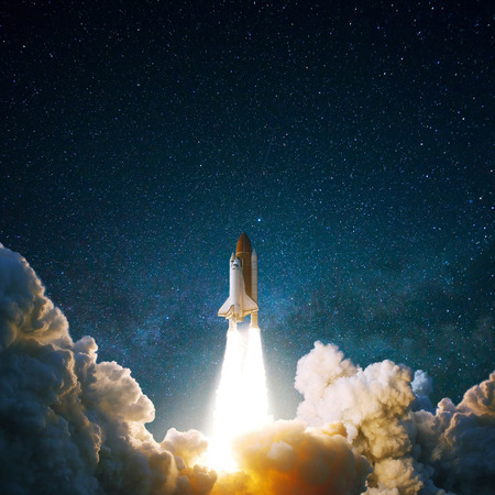 Spacecraft flies up into the starry sky. Rocket with smoke flies into space. Space Shuttle