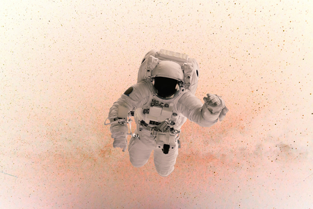 Space man flies in zero gravity on a pink background with stars. concept of travel in space
